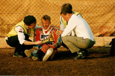 Photograph of an Injured Speedway Rider being attended to on the Track by Reading Centre Members and Doctor