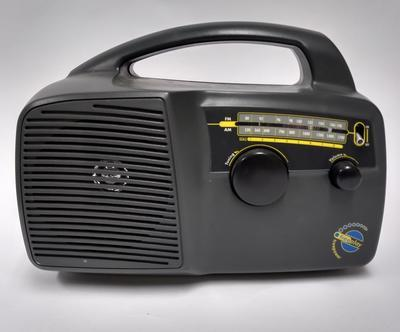 Black plastic AM and FM 'clock-work' radio