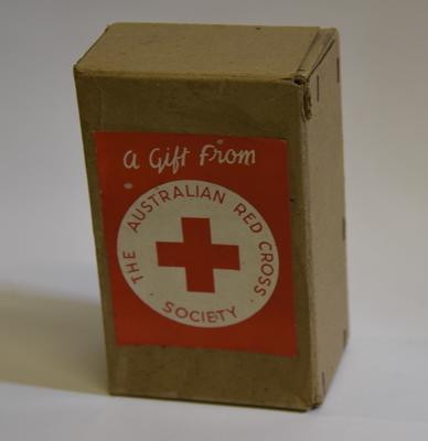 Small cardboard box with label: 'A Gift from The Australian Red Cross Society'