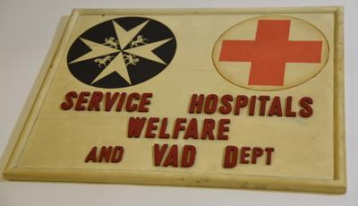 Wooden sign: 'Service Hospitals Welfare and VAD Dept'