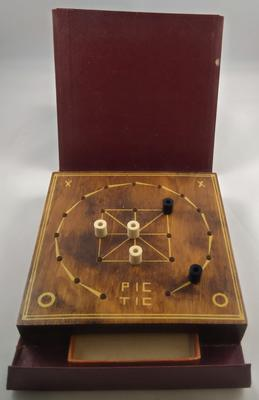 Wooden 'Pic Tic' Board game in a leather case