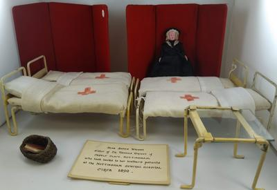 Toy hospital set depicting Miss Sophie Wright taking books to patients at  Nottingham General Hospital