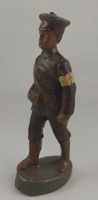 Small model of walking Red Cross orderly in battle dress