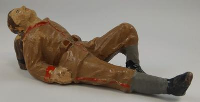 Small model of resting soldier, unknown uniform