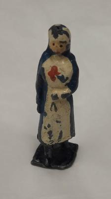 Small, hand painted, lead figure of a VAD in uniform
