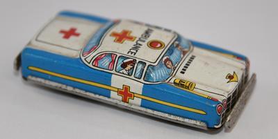 Tin friction powered toy car, marked ambulance