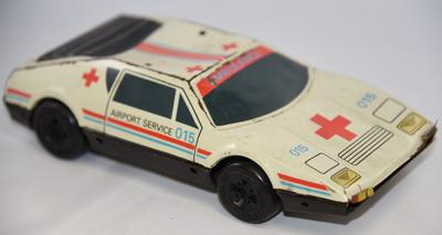 Painted metal toy car marked 'Ambulance' and 'Airport Service'