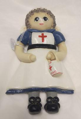 Doll in the form of a British Red Cross VAD member with collecting tin.
