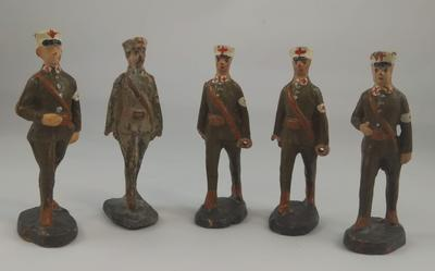 Set of five identical figures in khaki uniforms with the Red Cross emblem on their sleeves