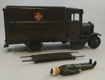 Model military ambulance with stretcher and patient
