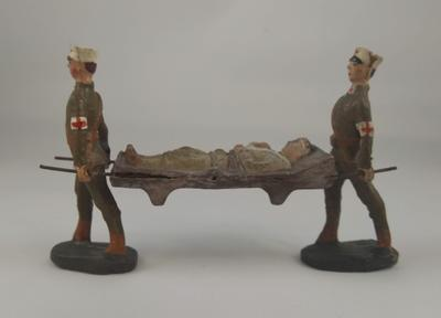 Hand painted model of two stretcher bearers carrying a stretcher