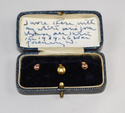 Three gold uniform studs in a leather box, belonging to Rosemary Winstanley