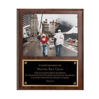 A framed photograph and plaque gifted by the American Red Cross in appreciation for help by the British Red Cross Society after 9/11