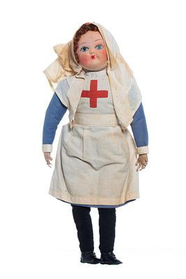 Cloth doll wearing the uniform of a British Red Cross nurse