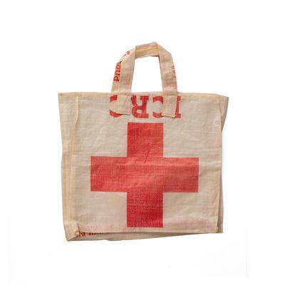 Two carrier bags made from flour sacks