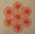 Table mat made from seven delicate flower-shaped pink string roundels