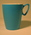 Blue polythene mug, white inside, made by Gaydon.