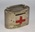 Small, oval, British Red Cross collecting tin with handle and locking mechanism