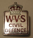 WVS badge (silver with red letters)
