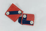 Two small pieces of cloth, red/blue with white buttons