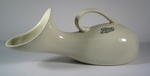 White china urinal with handle: 'Boots The Chemists'