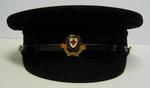 peaked cap, male, with white cap cover and officer's cap badge.