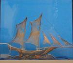 Silver filigree sailing vessel in glass case, of oriental design.