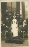 Ethel May Hennah, wearing British Red Cross uniform, with Belgian convalescent soldiers outside Oakley VAD Hospital in Bromley, Kent