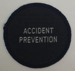 Circular cloth badge: Accident Prevention