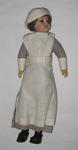 doll dressed as a nursing superintendent
