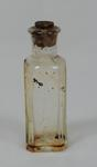 Small glass bottle, once contained Clock Oil
