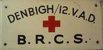 Wooden sign: 'Denbigh/12 VAD BRCS'