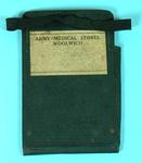 brown cardboard wallet with elasticated fastening, pen/pencil holder to right and sticky label to front with the words 'Army Medical Stores, Woolwich'.