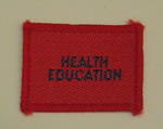 Plain red cloth badge for Youth uniform 'Health Education'.