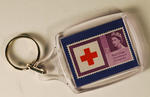 plastic keyring which contains an original 3d stamp comemmorating the Red Cross Centenary Congress in 1963