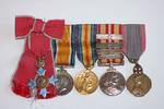 Miniature medal bar: MBE, British War Medal, Victory Medal, Voluntary Medical Services medal with 4 bars, and the Queen Elisabeth of Belgium Medal.