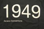 black t-shirt, with the words '1949 Geneva conventions'