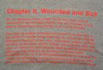 t-shirt with part of the Geneva Conventions reproduced in pink letters