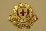 Nigerian Red Cross Society hat badge, made by JR Gaunt, Birmingham.