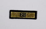 Service award consisting of a gold stripe with '20' incorporated in the design: 20 Years Service.