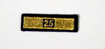 Service award consisting of a gold stripe with '25' incorporated in the design: 25 Years Service.