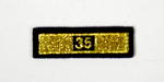 Service award consisting of a gold stripe with '35' incorporated in the design: 35 Years Service.