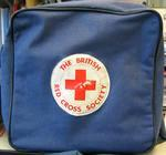 cloth bag with adjustable long strap, 'The British Red Cross Society' roundel on front