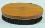 clothes brush with wooden top, stamped 'Gift of the Red Cross & St John'