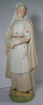 Porcelain figure of a Red Cross nurse