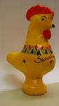 Small model chicken, painted yellow, with Savonlinna written on it. With several holes through it, whistle ? There is a sticker on the base with the word 'Finland'.