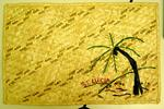 Decorative straw mat with a palm tree design from 'St Lucia'