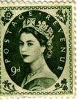 9d postage stamp featuring the head of Queen Elizabeth II