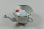 Feeding cup, large, with gold rim and fluted sides, emblem in double circle.