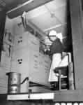 A British Red Cross VAD checking supplies in mobile first aid unit